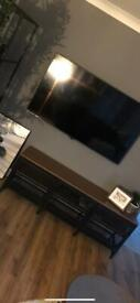 Black IKEA television stand.