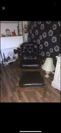 Black leather rocking chair and foot stool