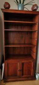 Indian hardwood bookcase with cabinet, by John Lewis