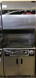 FRYMASTER TRIPLE ELECT DEEP FRYING STATION & WELLS CVS2000 VENTLESS FLAT TOP GRILL
