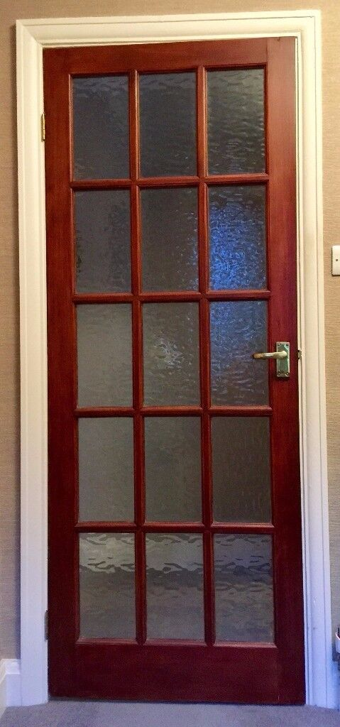 Internal, mahogany stained glazed doors complete with glass and all door furniture