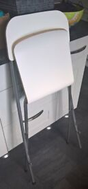 Tall folding chair/stool with back