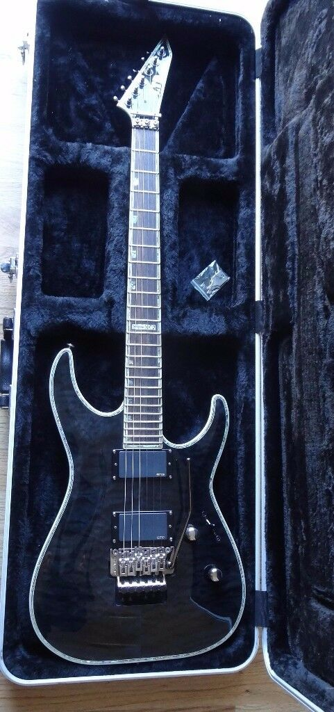 ESP LTD Deluxe MH-1000FR See-thru black excellent electric guitar with flight case RRP £820