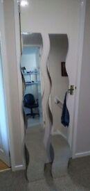 Wavy wall mirror . Size. H 140 W 20 D 0.4