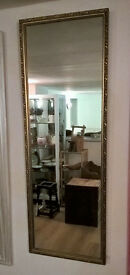 Gold and black ornate wall mirror