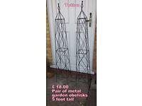 pair of ornate metal obelisks 5 foot tall