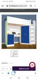 Kids high sleeper cabin bed with desk and wardrobe