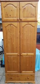 solid pine-wood wardrobe, top box, hanging rail, drawer. Sturdy strong quality. very good condition.