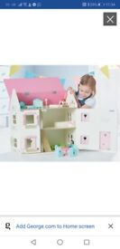 Wooden dolls house and matching accessories- immaculate condition