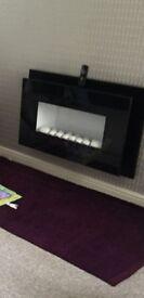 Modern Centre Electric Fire Piece.