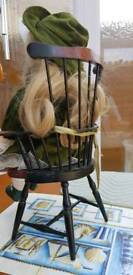 Dressed doll in Kitchen chair.