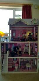 Large dolls house with large amount of accessories.