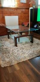 Glass coffee table with walnut legs