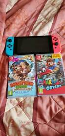 nintendo switch plus 2 games