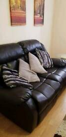 2xtwo seater black leather sofas