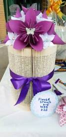 Handmade origami flowers on a book folded stand