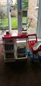 Kids drawing table and kids supermarket with trolley