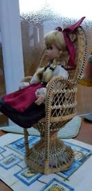 Dressed doll in chair