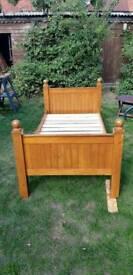 Pine single bed.
