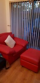 Red leather arm chair and foot stool