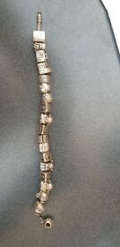 2 pandora bracelets with charms used but in good condition. Willing to separate.