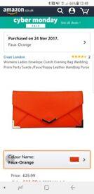 Brand New Orange Clutch Bag