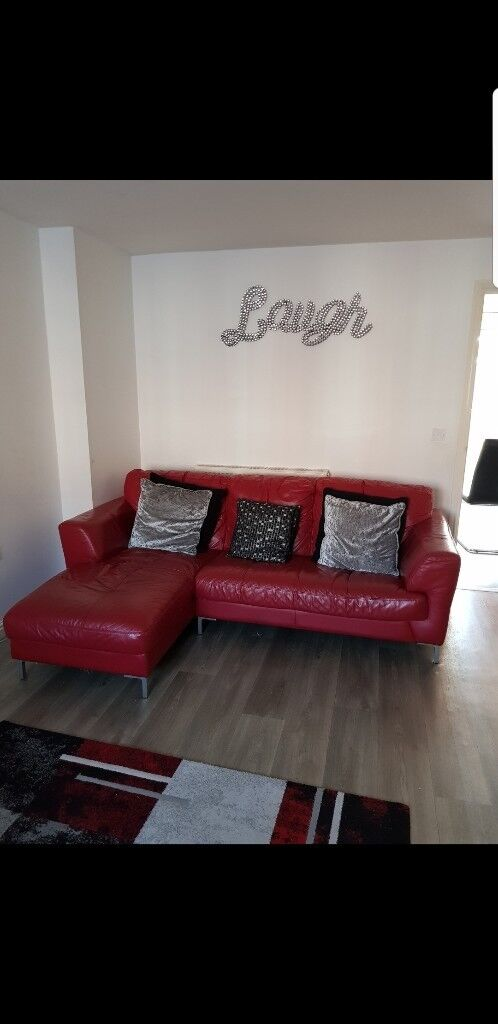 Red leather corner sofa with leather cleaning equipment