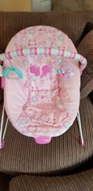 Pink baby bounching chair with activity bar