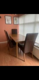 Wooden Dining table and 6 chairs in brown leather