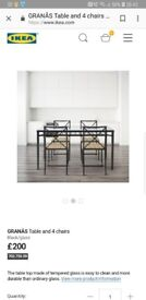 Ikea glass top metal table and 4 chairs