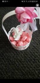 Cherub in a basket with pink stones and fairy dust bottles