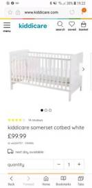 White wooden kiddicare cotbed