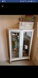 White glass shelved cabinet