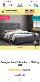 King-size grey fabric bed with matress