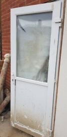 Front French double glazed door with side panels.