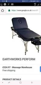Portable massage table. Earthworks