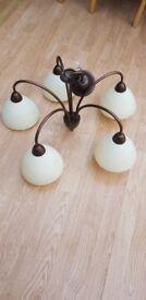 Antique dark copper light fitting with 5 cream lamp shades
