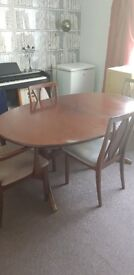 Extendable Dining table and 5 chairs perfect to fix up