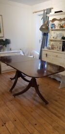 Extending dining table seats upto 10