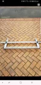 A rear roller for van roof rack