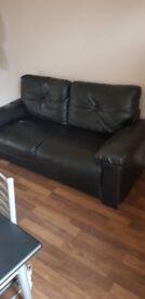 2 seater black leather settee