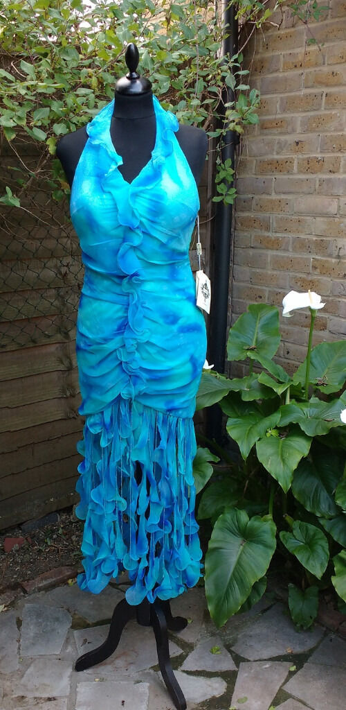 100% Silk Prom/evening dress with tassles and beaded hem size 10 BNWT sky bluein Hackney, LondonGumtree - Sky Blue 100% Silk Prom/Evening/ Special occasion dress Size 10 Brand new with tags Carducci special occasion/evening dress with beaded hem and frill detail. Lovely 100% light silk, on top of a stretchy satin lining that is stretchy and will fit a...