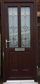 Lovely wood grain (brown) pvcu door, size 880 x 2095, £100.