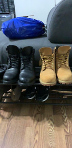 Two pair of timberlands boots one black one beige