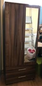 Two door Cupboard/wardrobe with mirror on one door and 2 bottom drawers.