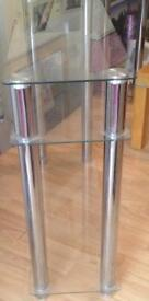 2 Glass console tables will sell separate