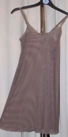 New, women's mink coloured, under-slip. Great quality. Lace edged. 2 available, sizes 8 & 10.