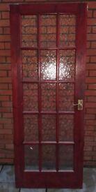 Solid wood internal door with glass panels
