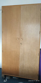 Wardrobe with shelf in one half and cloth hanger in another half. Fair condition