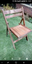 Five Folding wood chairs